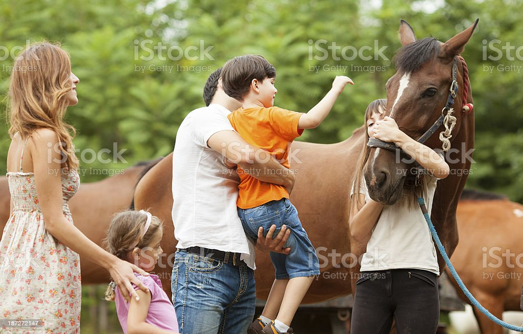 Family Visit Horse Riding School. royalty-free stock photo