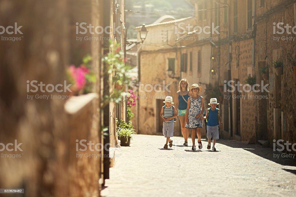 Family visiting beautiful mediterranean town. stock photo