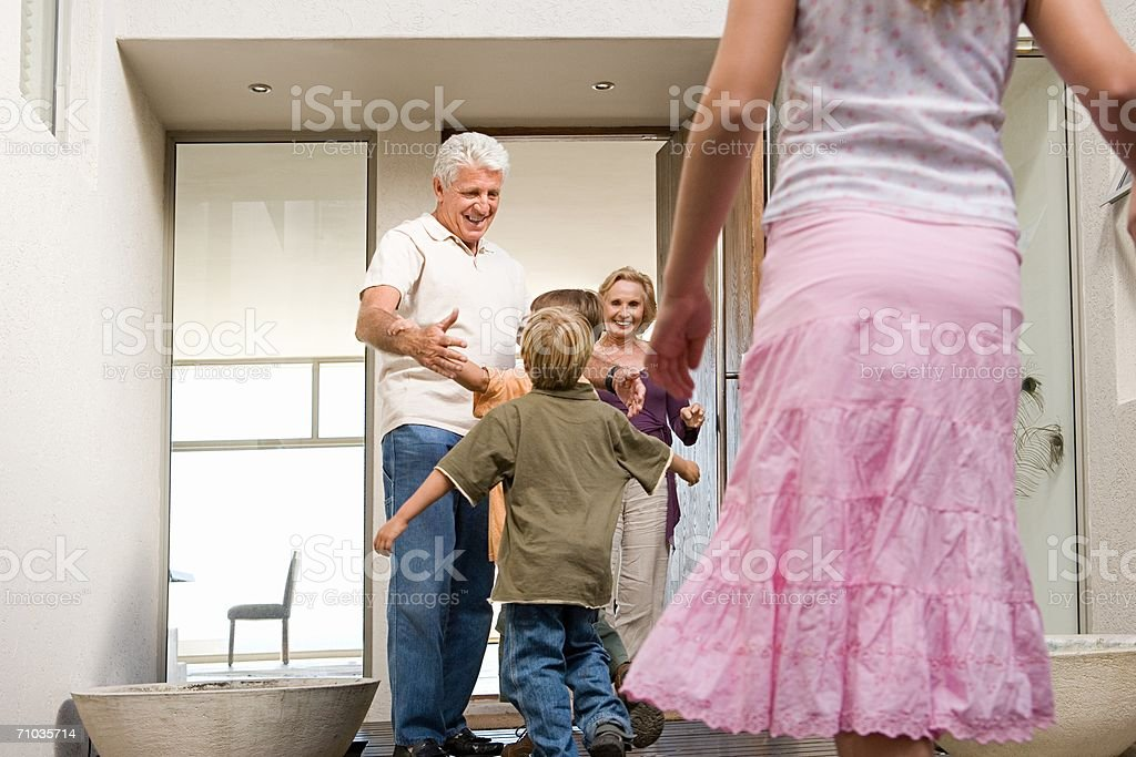 Family visiting grandparents royalty-free stock photo
