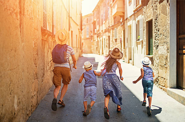 family visiting mediterranean town on majorca - europe travel stock photos and pictures