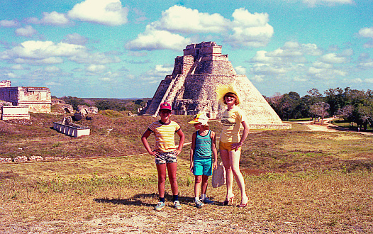Family visitng the Pyramid of the Magician in Uxmal, in the Yucatan peninsula in Mexico, Mayan Arqueological Site.