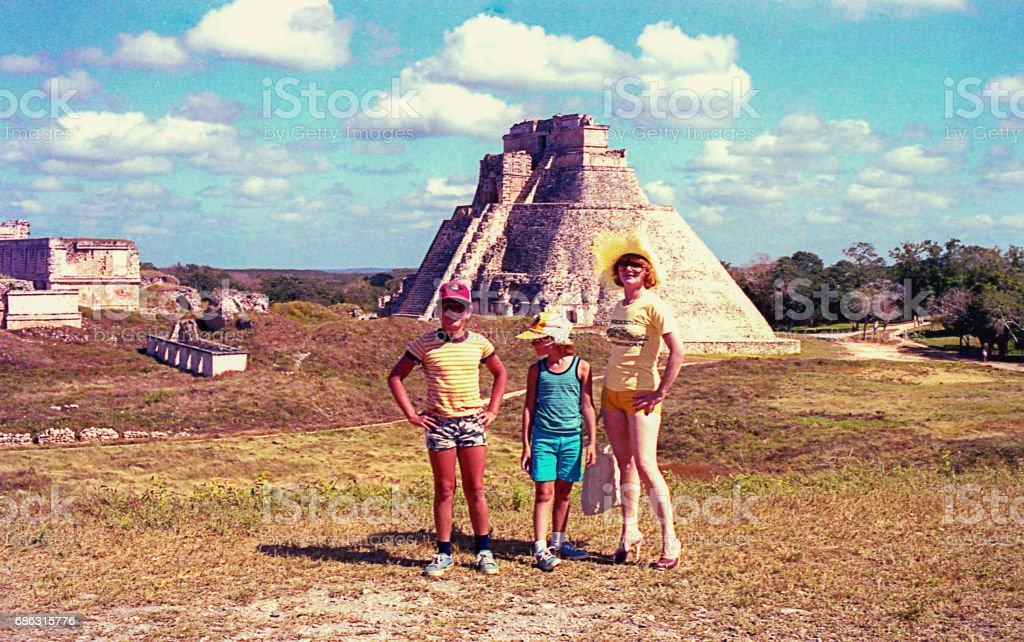 Family visiting the Pyramid of the Magician in Mexico stock photo