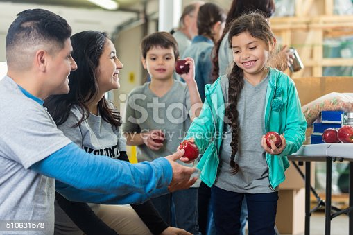 istock Family volunteers at food bank 510631578