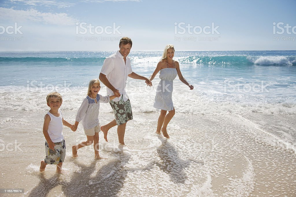 Family wading in ocean royalty-free stock photo