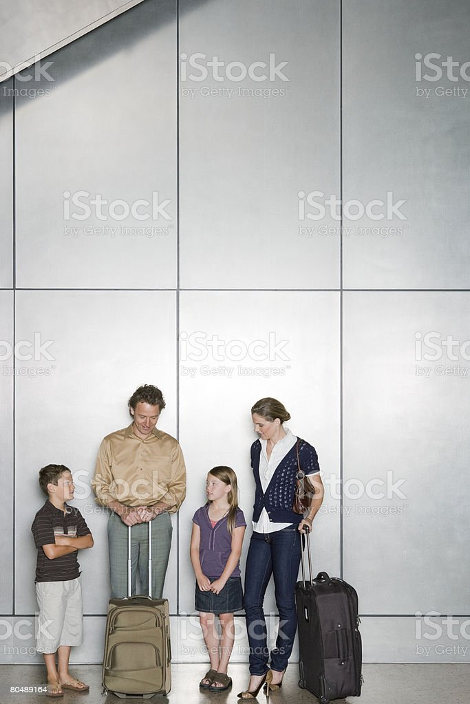 A family waiting in an airport royalty-free stock photo