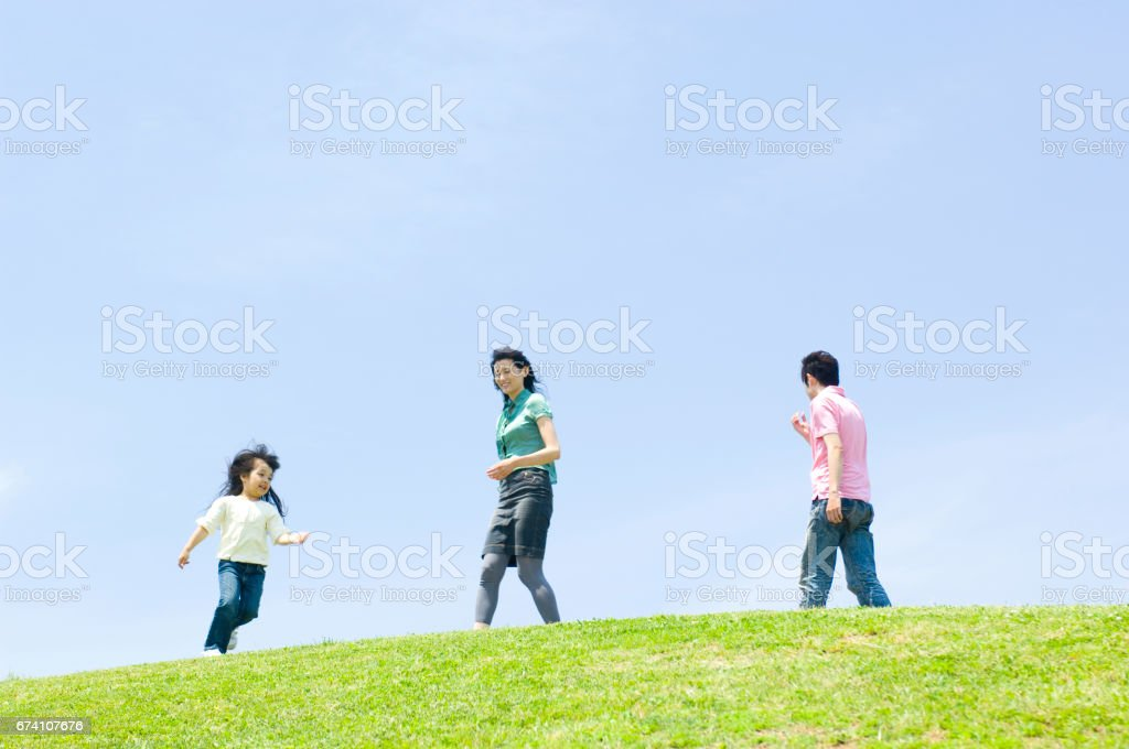 Family walk around the top of the Hill royalty-free stock photo