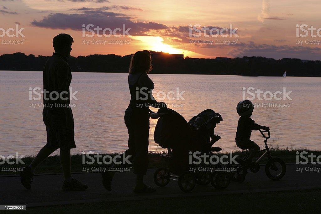 Family Walk at Sunset royalty-free stock photo