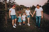 istock Family walk in a blackberry field 1265307988