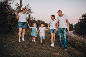 istock Family walk in a blackberry field 1265309150