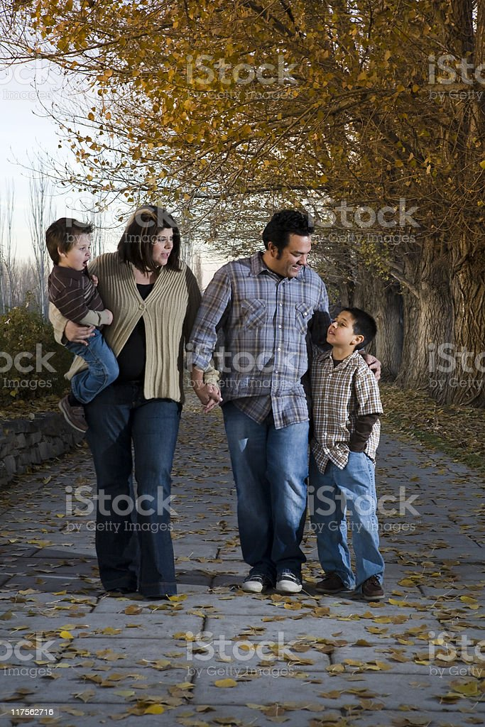 Family walk in the leaves royalty-free stock photo