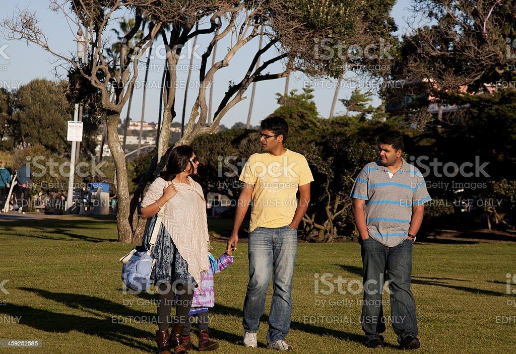Family Walking Across a Park royalty-free stock photo