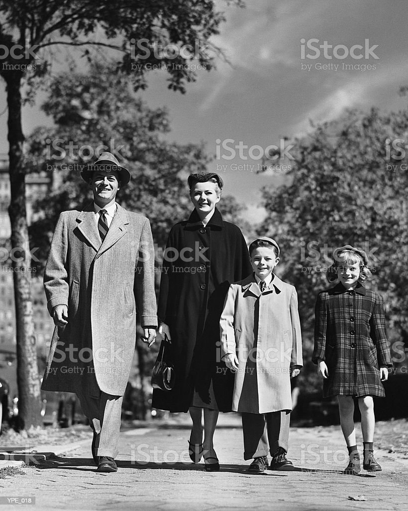 Family walking along street royalty-free stock photo