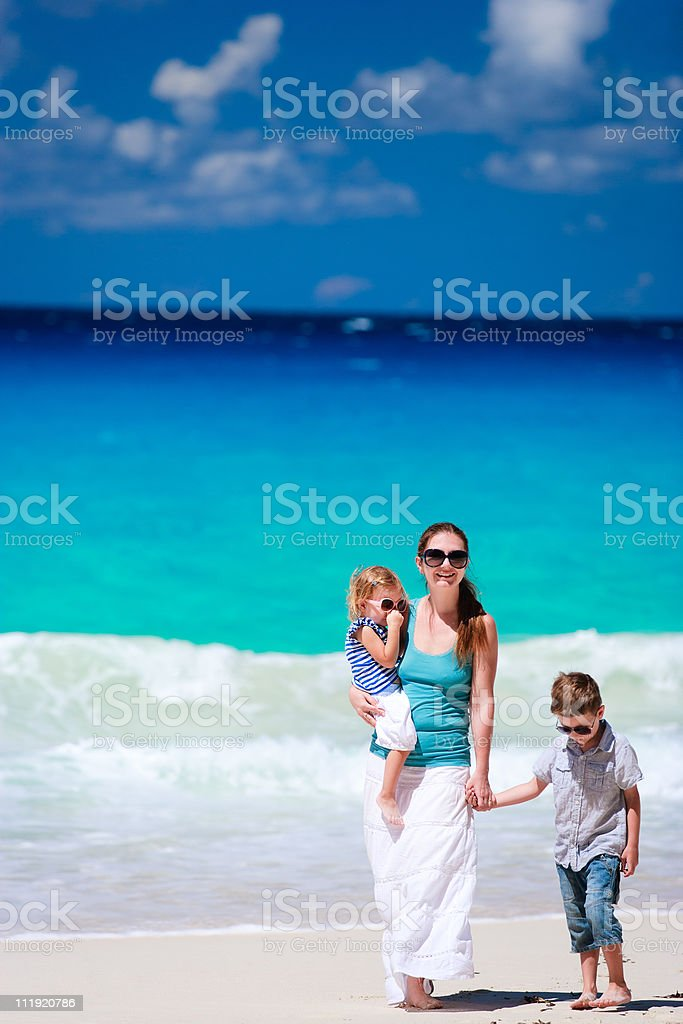 Family walking along the beach royalty-free stock photo