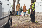 istock family walking and holding hands 903369458