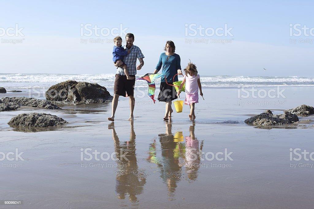 Family walking at beach royalty-free stock photo