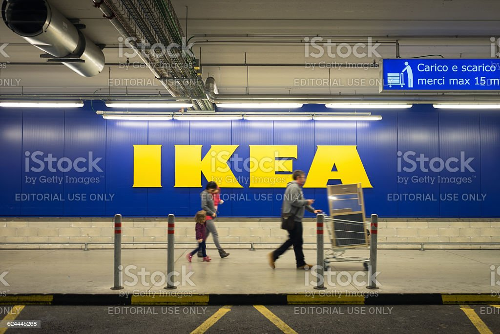 Family Walking At Ikea Store After Shopping