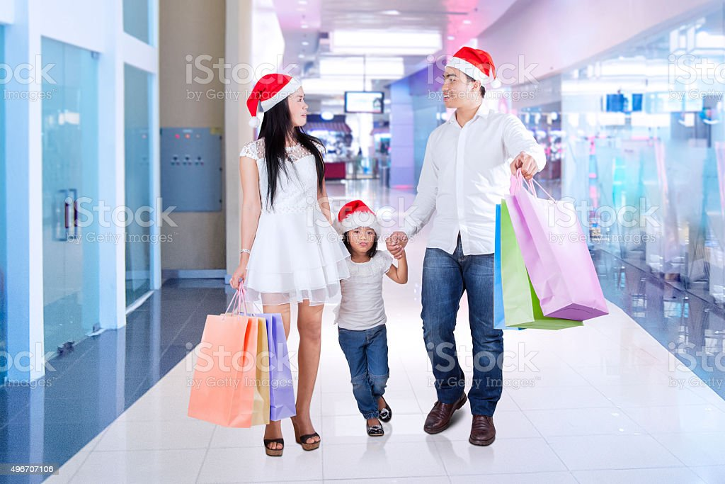 Family walking at shopping mall stock photo