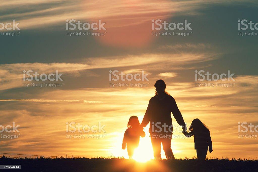 Family walking at Sunset royalty-free stock photo