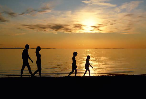 Family Walking Beach 2 stock photo