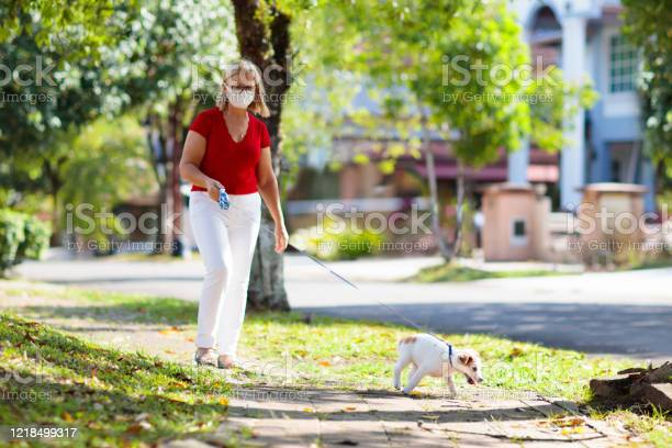 Family walking dog during virus outbreak picture id1218499317?b=1&k=6&m=1218499317&s=612x612&h=yfru2c5  husht5ed5cvfaxsunlgl0ve5z0m adj tu=