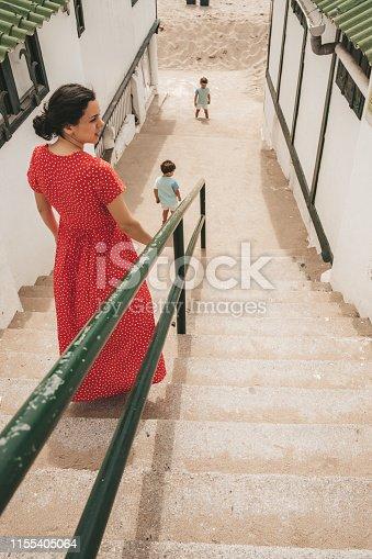 Family walking down the stairs in El Garraf, Spain