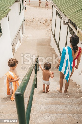 Family walking down the stairs in El Garraf, Spain