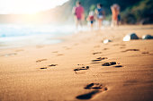 Background, Feet stand on sea sand and wave with copy space, Vacation on ocean beach, Summer holiday.