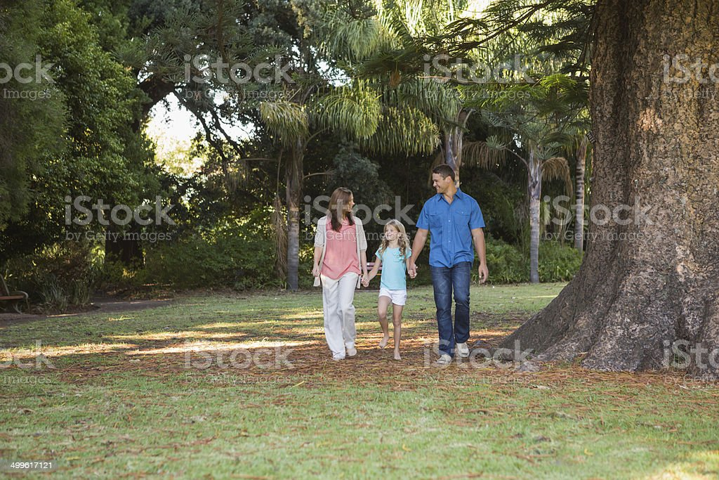 Family walking in a park stock photo