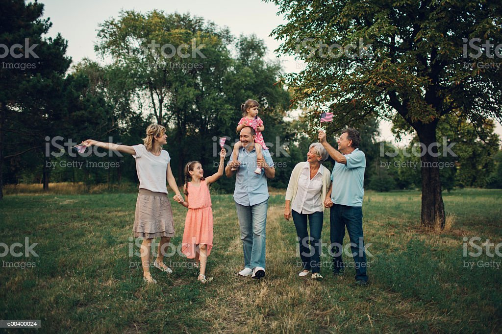 Family Walking In A Park. stock photo