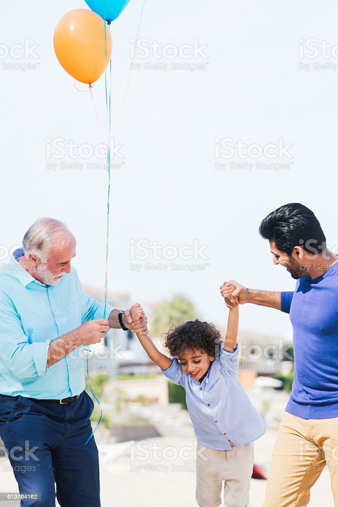 Family walking in Dubai and sharing and afternoon outdoors. stock photo