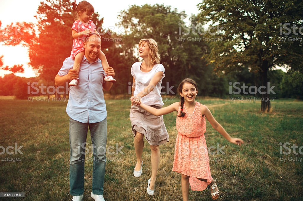 Family Walking In Nature Together. stock photo