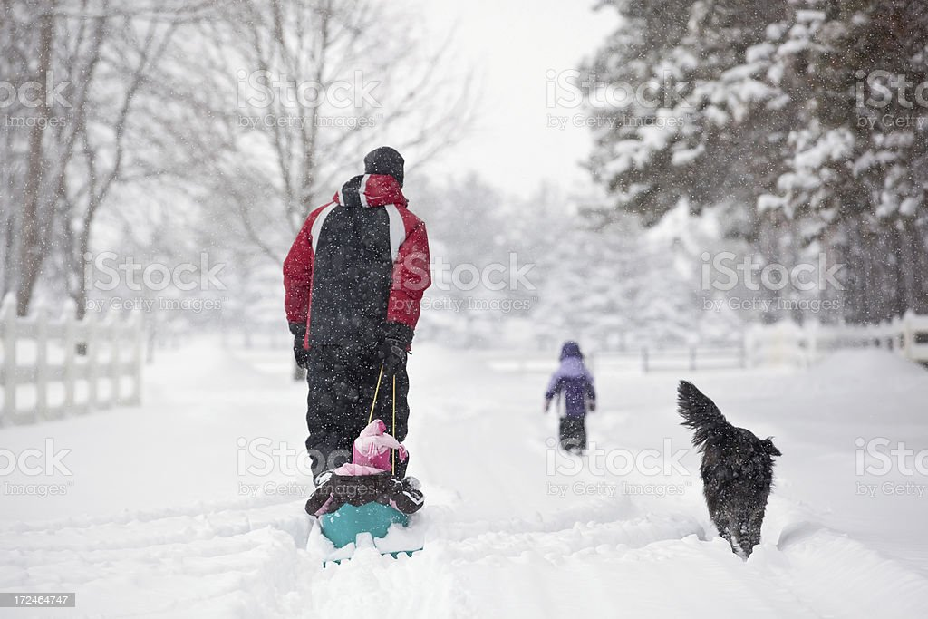 Family Walking in Snow royalty-free stock photo