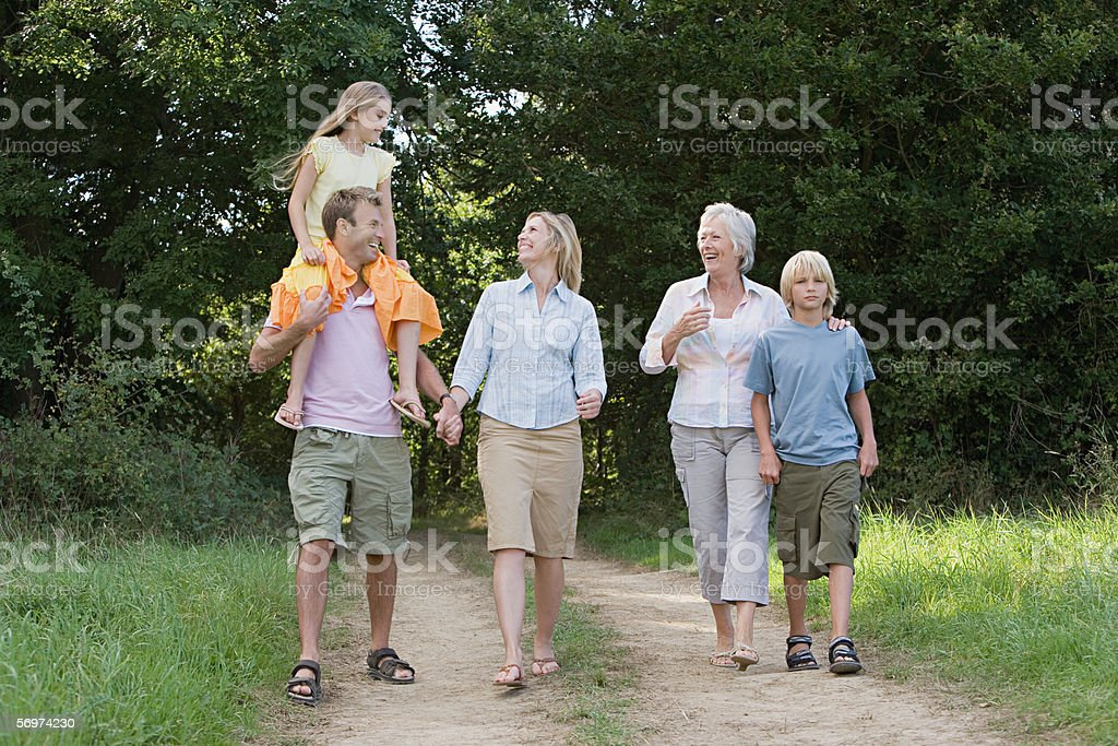 Family walking on a dirt track royalty-free stock photo