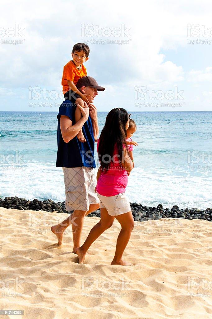 Family Walking on a Hawaiian Beach royalty-free stock photo