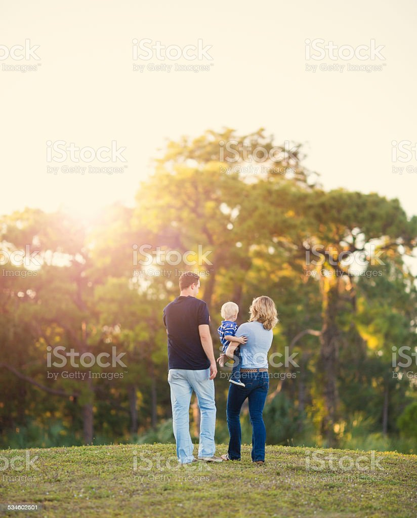 Family walking on a hill stock photo