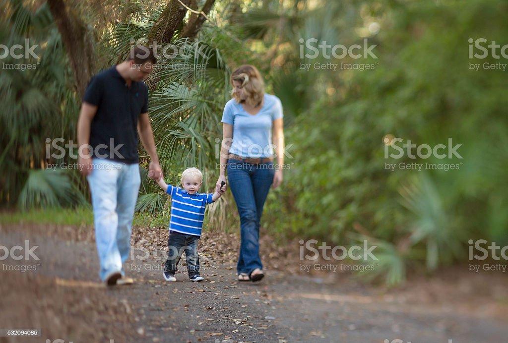 Family walking on a park stock photo
