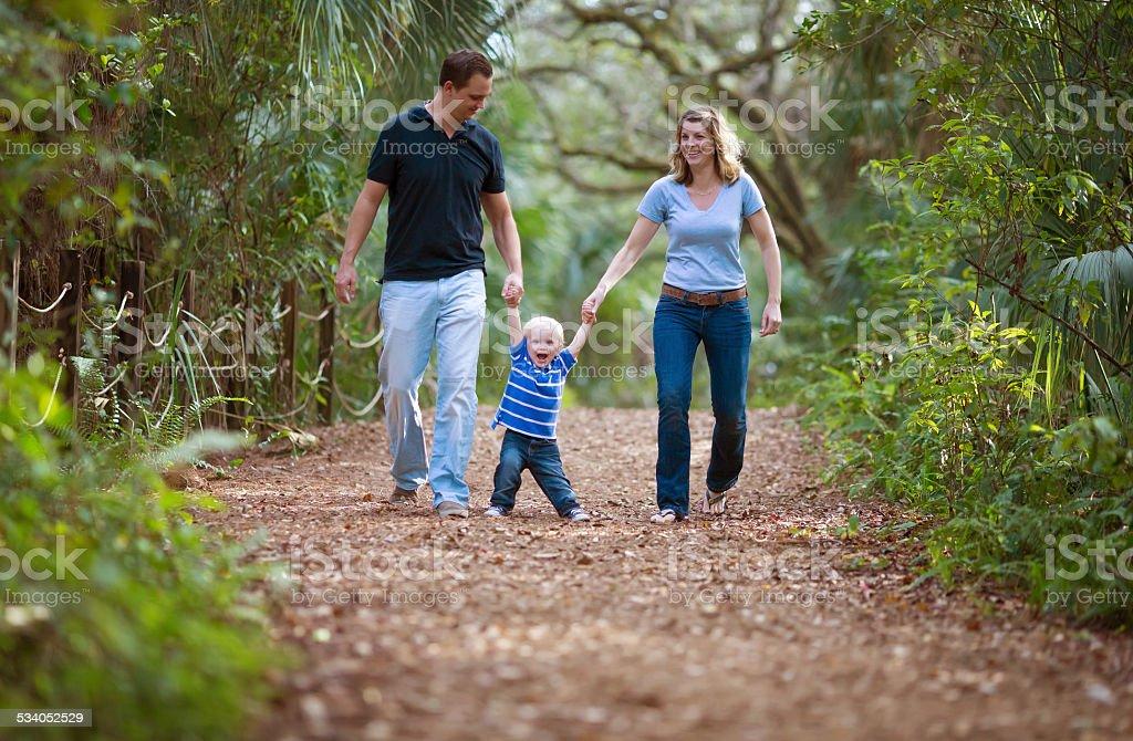 Family walking on a park. stock photo