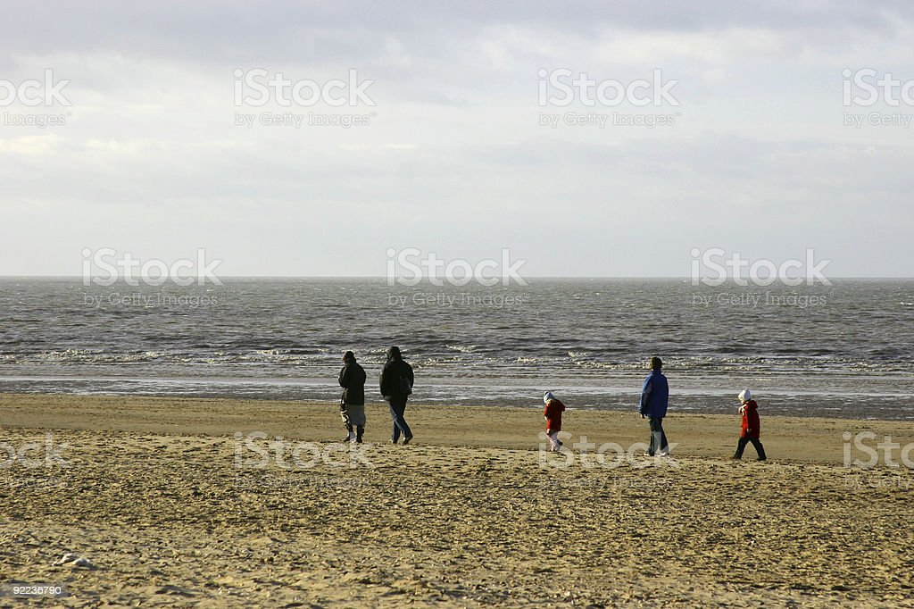 Family walking on Beach royalty-free stock photo