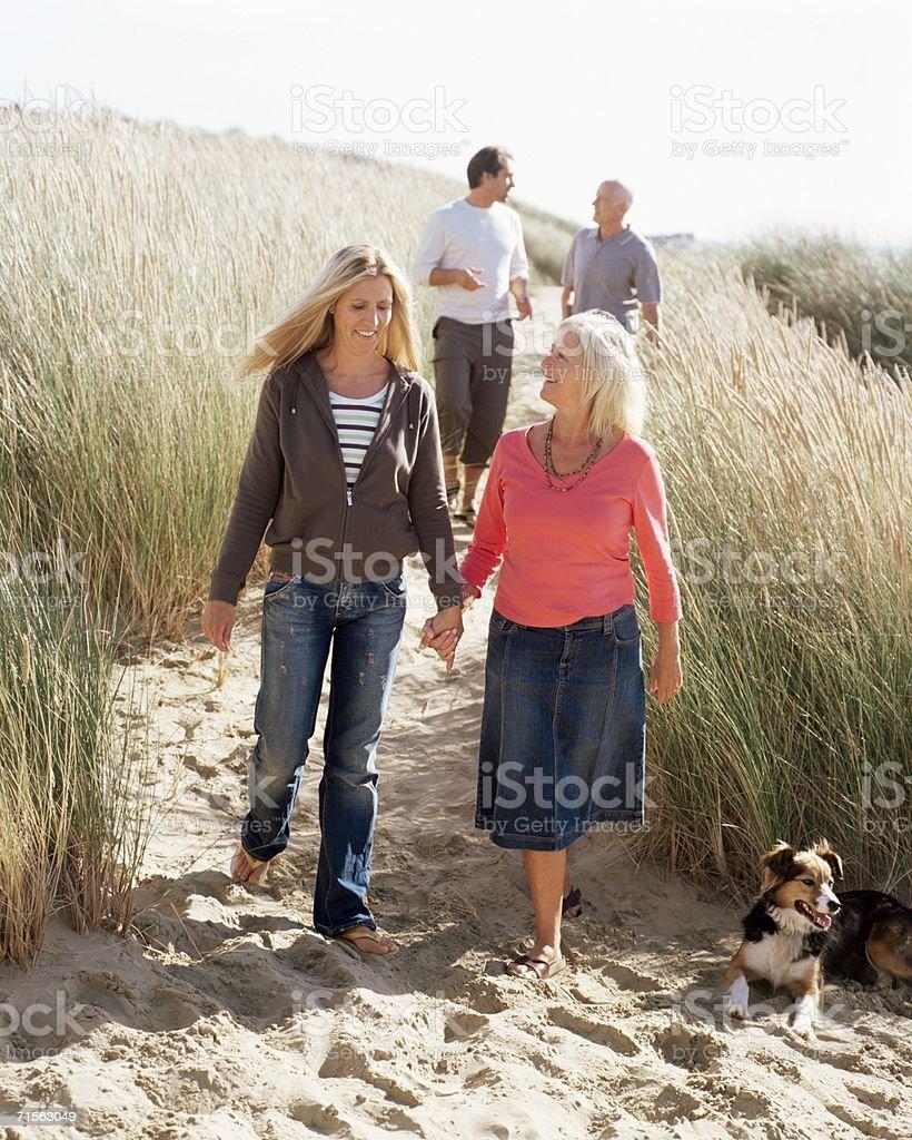 Family walking on dunes royalty-free stock photo