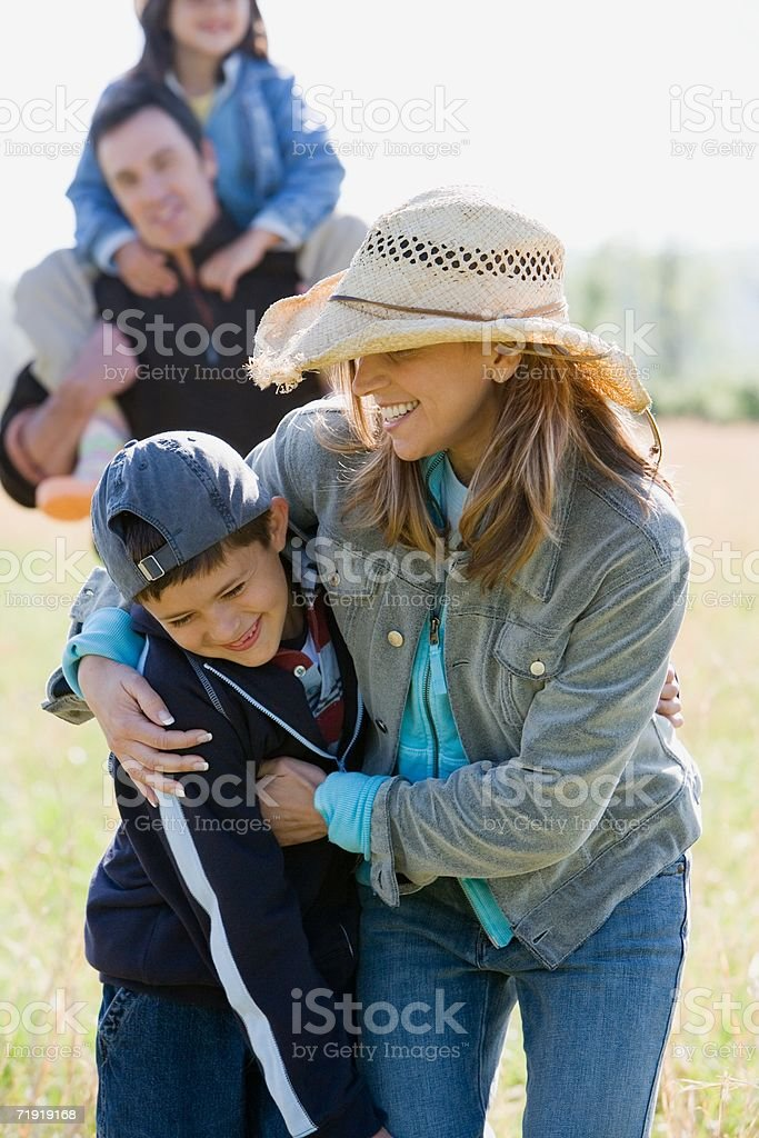 Family walking on field royalty-free stock photo