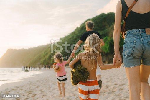 929671306 istock photo Family  walking on the beach in Bali 929671306