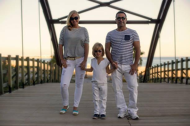 family walking on the bridge - liebeskummer englisch stock-fotos und bilder