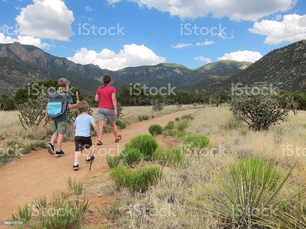 Family walking on trail stock photo