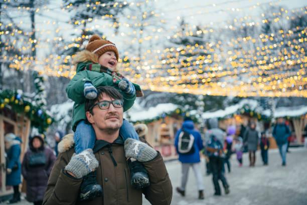 Family walking through Christmas market