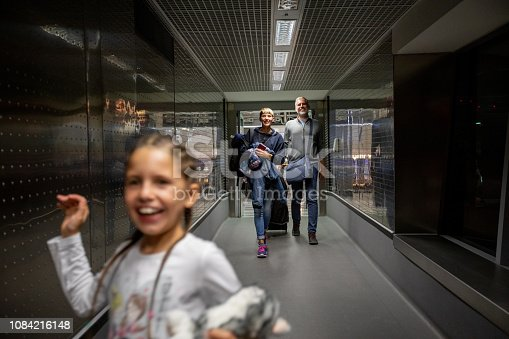 Family Walking Thru Corridor on Airport Departure Area.