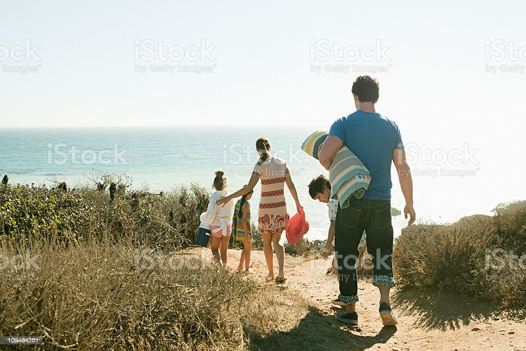 Family walking to beach stock photo