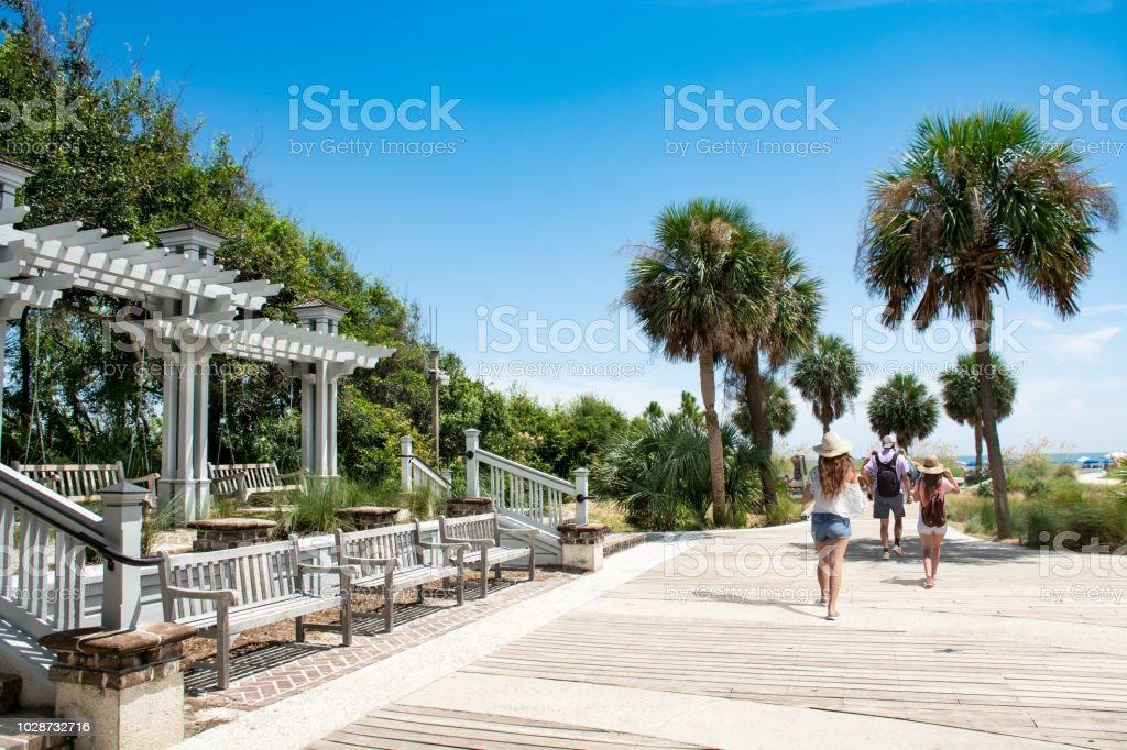 Family walking to the beach on summer vacation. stock photo