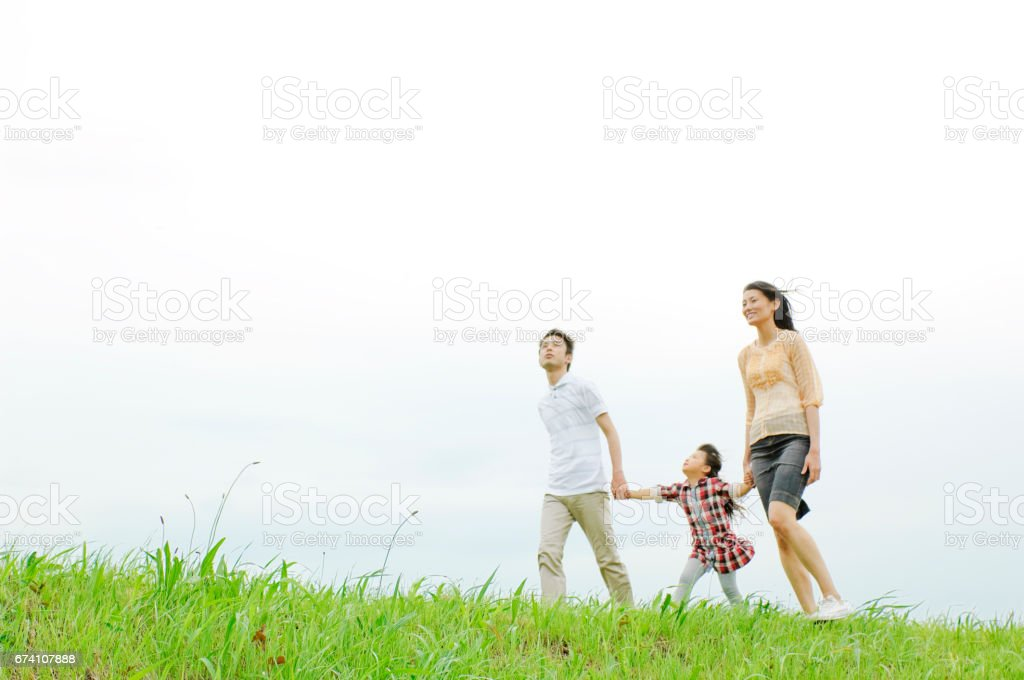 Family walks along the River to royalty-free stock photo
