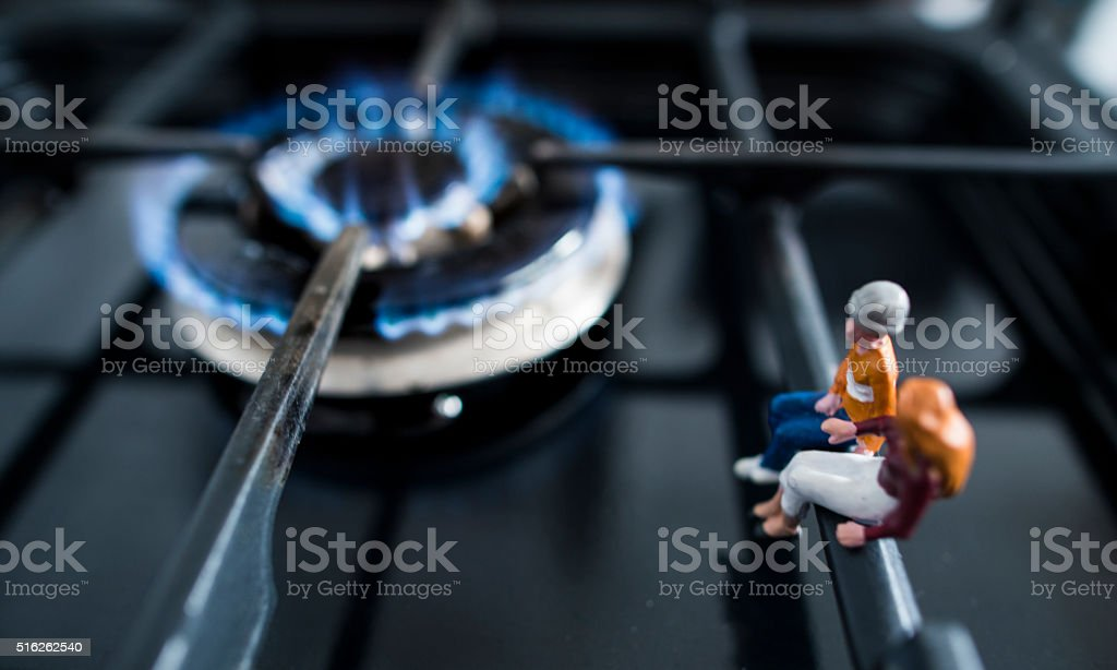 family warming up by the fire home heating stock photo