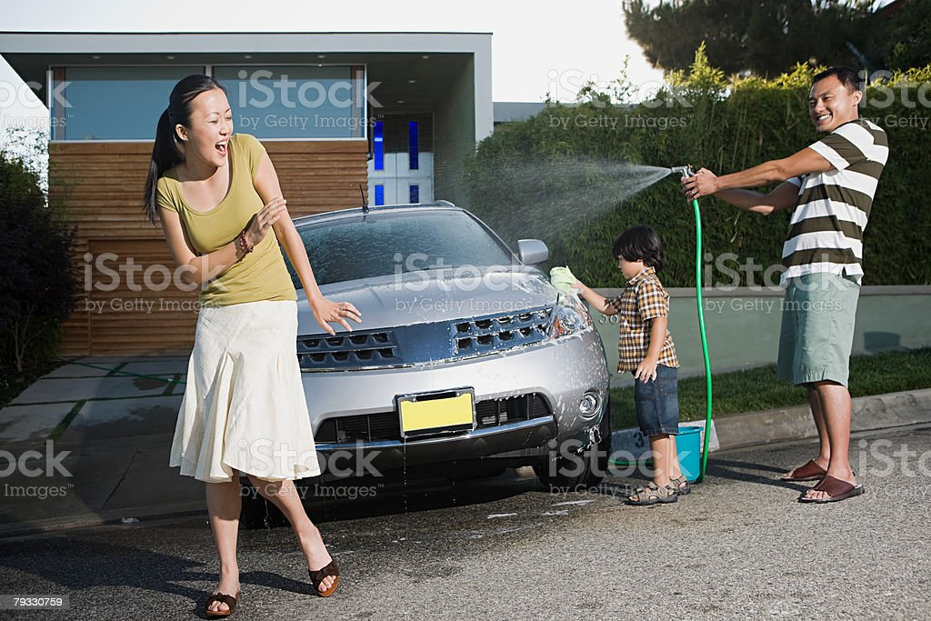 Family washing car stock photo